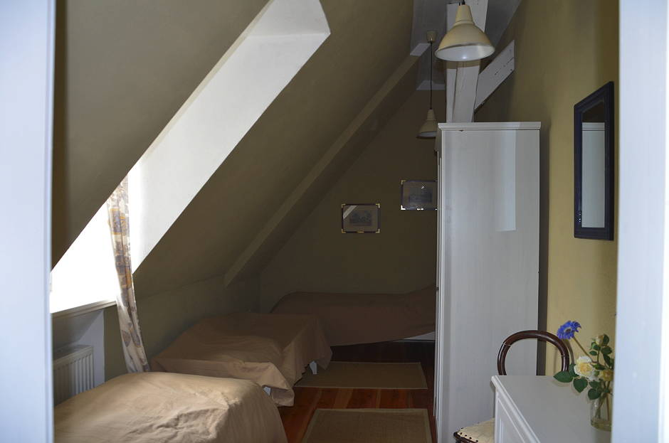 Familienfreundliche Ferienwohnung Schlafzimmer beige