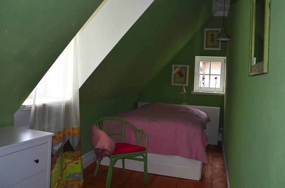 Familienfreundliche Ferienwohnung Schlafzimmer gruen